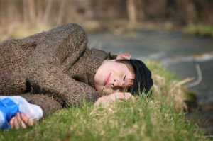 boy_laying_by_river